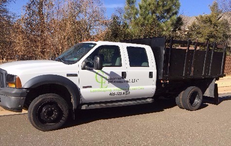 Cimarron Environmental landscape and lawn maintenance truck.